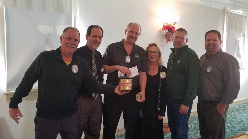 Our Chili cooks and the winner of the Golden Crock -- all in support of good cause --  Our Community!